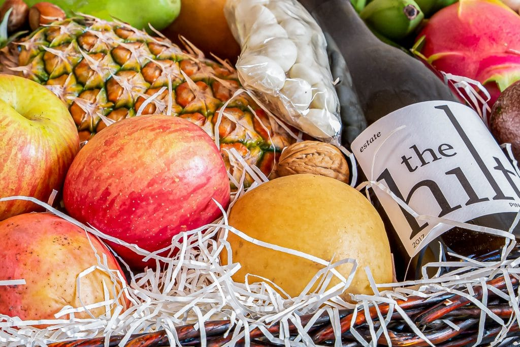 close up of fruit and bottle of 2017 The Hilt Estate Pinot Noir in Valentine's gift basket
