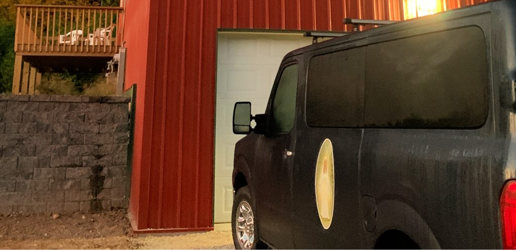 black van with picture of Mary, mother of Jesus on the door