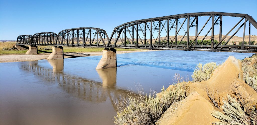 4 spans of through trusses on bridge over the smooth waters on Montana family-friendly trip