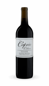 bottle of red wine with white label reading Caprio Cellars