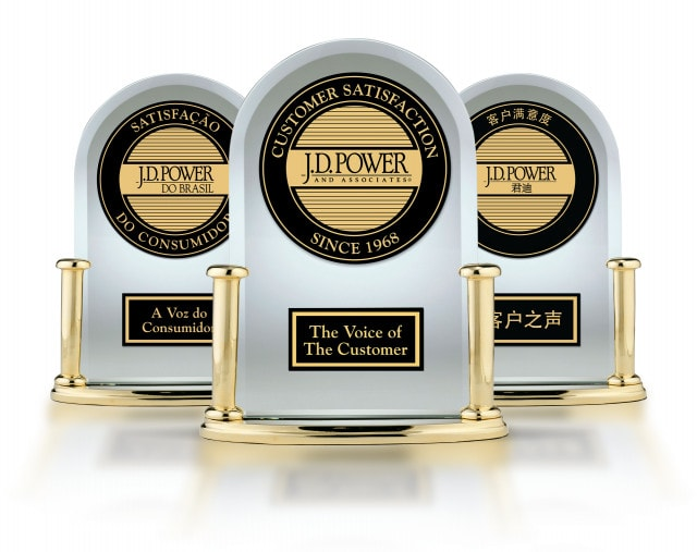 """three beautiful trophys in gold, black and white that say """"JD Power"""" and """"Customer Satisfaction"""" """"The Voice of the Customer."""""""